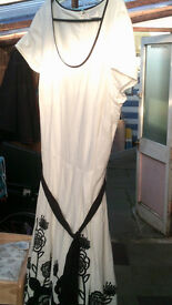 dress, size 16, per una, from M & S.white with black leaf/flower design