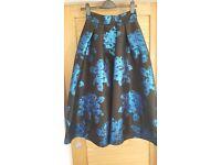 Coast skirt - black silk with blue embossed rose pattern.
