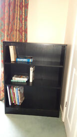Medium sized black wooden bookcase