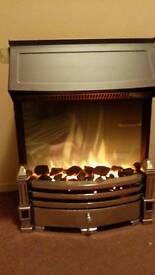 Illusional fireplace with 2 kilowatt heater built in
