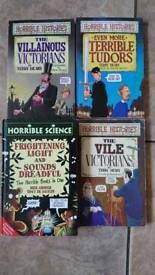 Four Horrible Histories books