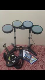 Playstation 2 drums and guitar set with rock band and band hero discs