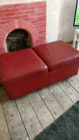 Red leather pouffe