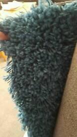 Large teal rug