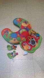 Tummy time cushion and feet rattles