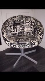 Ikea black and cream patterned swivel chair.