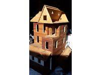 Superb wooden dolls house needing work