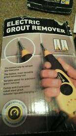 Tile force electric grout remover. .
