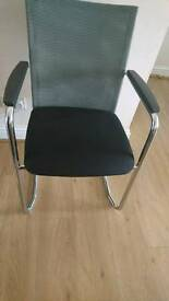 Tubular black/grey meshed back office chairs.