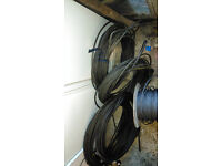 REELS OF STRONG STEEL CABLE! INDUSTRIAL! HEAVY DUTY! UNWANTED! CHEAP! OPEN TO SERIOUS OFFERS!