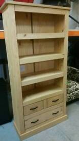 A brand new pine 3 drawer 4 shelve unit.