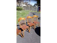 Round dining table and four chairs with seat cushions, good condition and quality