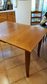 Solid oak extendable table and 4 chairs.