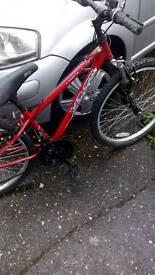 Boys Apollo mountain bike.suspension type.24 inch wheels