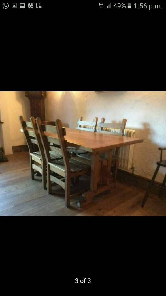 Solid oak farmhouse dining table with chairs