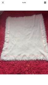 Beautiful crochet baby blanket with pink lace