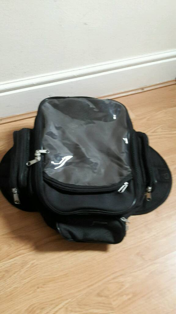 Motor bike Tank bagin Ipswich, SuffolkGumtree - Motor bike Tank bag with several compartments, held to tank with magnetic flaps and with a waterproof cover, never used