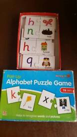 Alphabet puzzle game and rhyming cards game