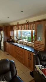 Medium walnut shaker kitchen