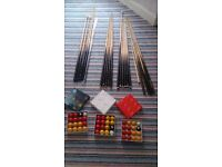 Range of snooker and pool cue sticks and ball sets (varying prices)