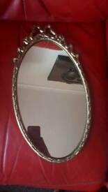 Lovely gold wall hanging mirror quite heavy