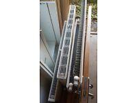 Radiators and chrome towel rail