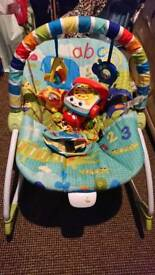 Baby chair, with a small selection of toys.