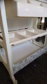 Baby changing unit with storage shelves and baby bath