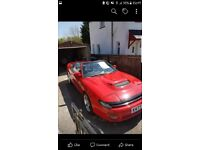 Red toyota celica soft top
