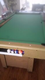 Solid 6ft pool table great condition comes with 2 cues and balls ...buyer to dismantle