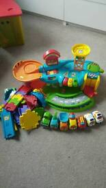 V tech Toot Toot Garage/Extra track/7 vehicles