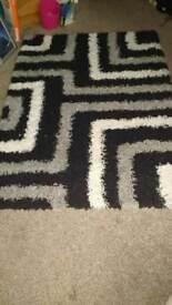 Black cream and grey rug
