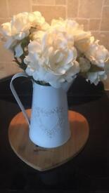 Jug with faux flowers
