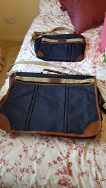 Case for suits and matching hand luggage bag