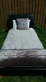 Single black faux leather black bed with luxury mattress