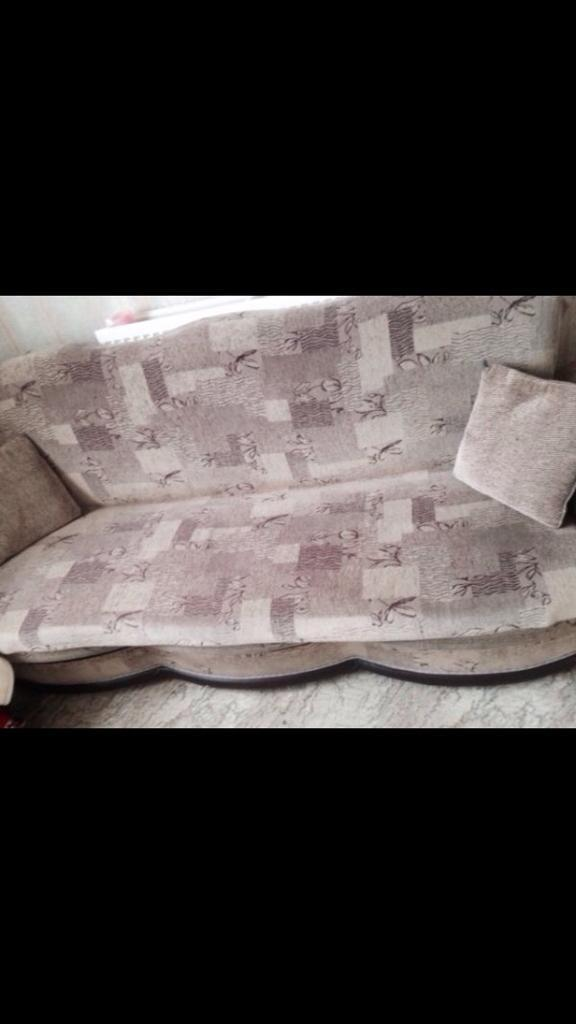 Three seater settee with pillows