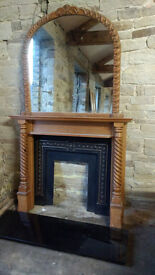 Solid pine fire surround with wrough iron inset, solid marble hearth and mirror. Good condition.