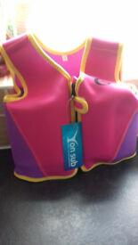2 Child Floatation/ swim jackets (both brand new)