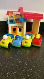 Toy garage with 4 cars