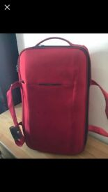 Samsonite red duffle bag style suitcase