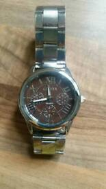 man's stainless steel watch
