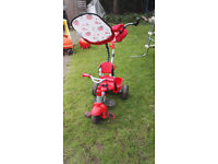 Toddler tricycle, with steering handle and sun shade