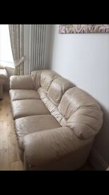 The set of 2 white leather sofas