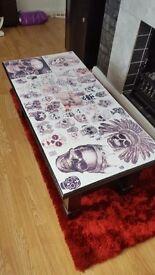 Chunky legged table with skulls on