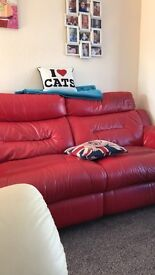 Red leather reclining sofa no rips couple scratches