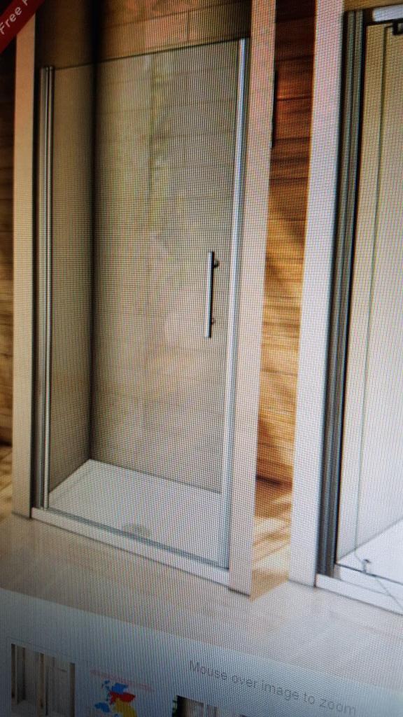 Frameless pivot glass shower door