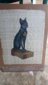 Cat on papyrus in a frame