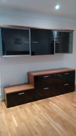Living room walnut and black gloss wall hung cabinet and free standing drawers