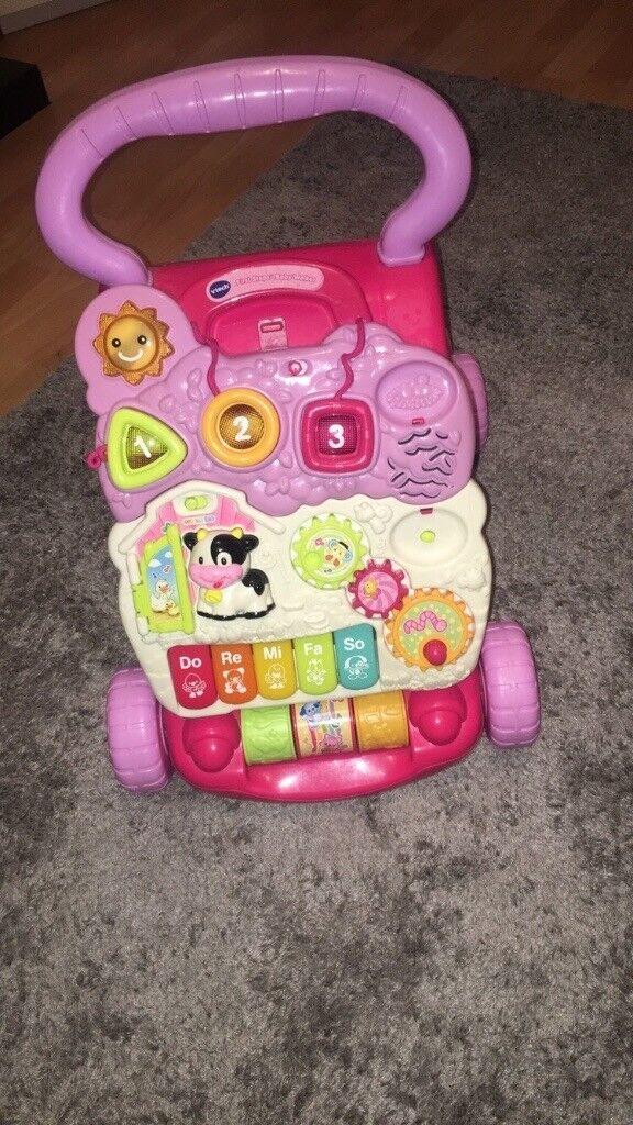 Baby girls pink activity walker