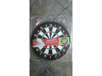 Boutique Dart board with two sets of darts, unused still in packaging.